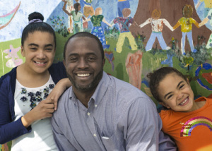 Tony Thurmond and his two daughters.